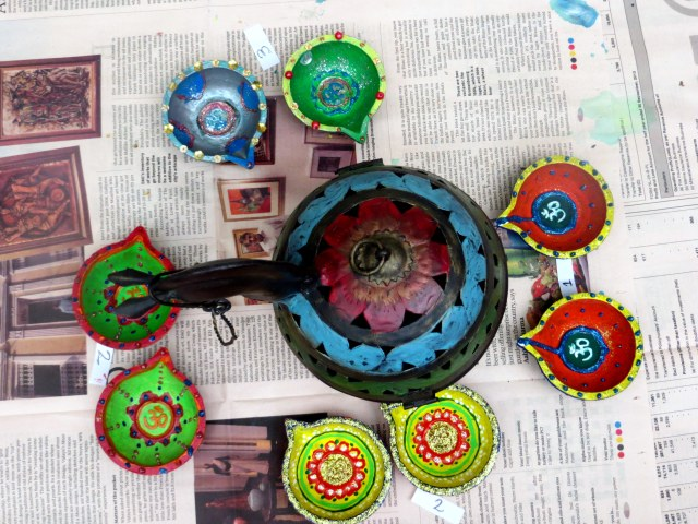 Some decorated diyas on display.